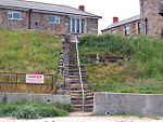 Steps from the small beach beside the harbour, Seahouses