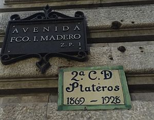 Francisco I. Madero Avenue - Modern street sign and plaque with the former name of the section, Calle de Plateros.
