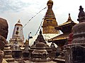 Swayambhunath stupa along with Harati Devi's temple and smalles stupas and pagodas in the foreground.jpg