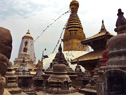 Swayambhunath stupa along with smalles stupas and pagodas in the foreground