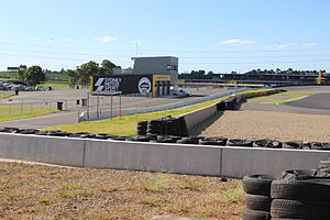 Sydney Motorsport Park - The secondary pit lane constructed for the South Circuit. The main pit lane and grandstand can be seen in the background.