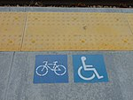 TRAX bicycle & disability access signs on passenger platform, Apr 16.jpg