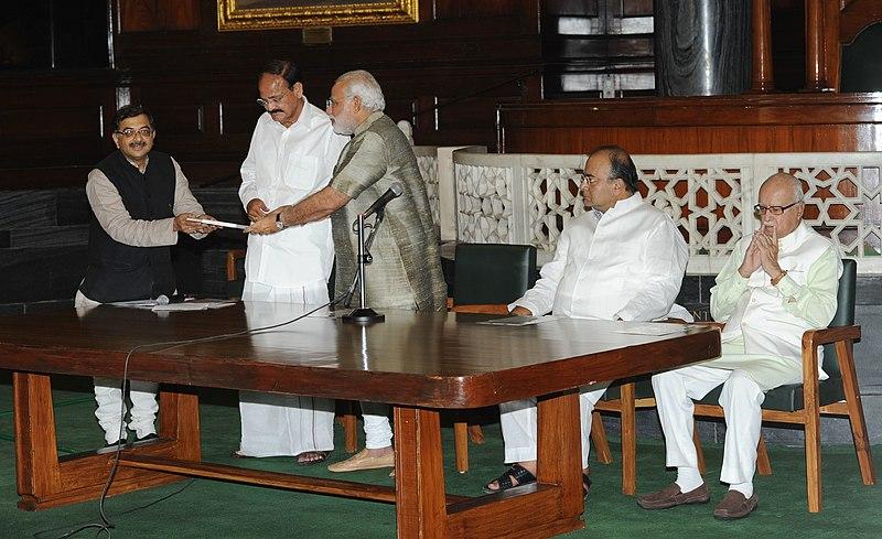 File:Tarun Vijay presents a book to PM Modi.jpg