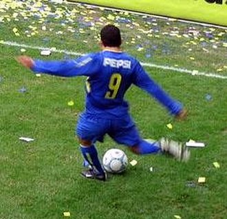 Carlos Tevez - Tevez playing for Boca Juniors in 2004