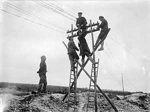 1st Lancashire Engineers - RE signallers repairing an air-line on the Western Front