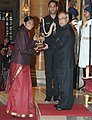 The President, Shri Pranab Mukherjee presenting the Arjuna Award for the year-2014 to Ms. Tintu Luka for Athletics, in a glittering ceremony, at Rashtrapati Bhavan, in New Delhi on August 29, 2014.jpg