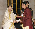 The President, Smt. Pratibha Patil presenting the Arjuna Award -2006 to Ms. Geetika Jakhar for Wrestling at a glittering function, in New Delhi on August 29, 2007.jpg