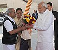 The Prime Minister, Shri Narendra Modi being welcomed on his arrival, at Mahatma Temple, in Gandhinagar on January 08, 2015. The Chief Minister of Gujarat, Smt. Anandiben Patel is also seen.jpg