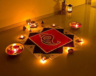 Diwali - Rangoli decorations, made using coloured fine powder or sand, are popular during Diwali.