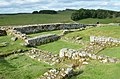 The foundations of Turret 36 B and the remains of a later rampart building along the north curtain wall, Housesteads Roman Fort (Vercovicium) (44567052691).jpg