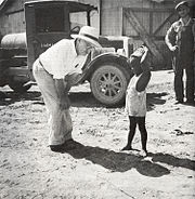 The owner of the Aldridge Plantation with one of the plantation children Leland (vicinity) June 1937