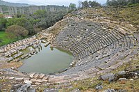 The theatre, erected in the Hellenistic period in the north slope of the south hill, its capacity was approximately 10,000 spectators, Caria, Turkey (20672152612).jpg
