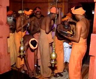 Thirunamam - Payyan Bala Janathipathi smearing Thirunamam for devotees in Vatakku Vasal