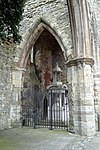 Titanic Memorial through Archway in Holyrood Church, Southampton.jpg