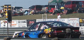 Drag racing type of motor racing in which automobiles or motorcycles compete