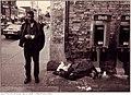 Two men beside empty building, north-west corner of Queen Street West and Bathurst Street.jpg