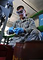 U.S. Air Force Senior Airman Harold Callaway, a fuels laboratory technician with the 39th Logistics Readiness Squadron, handles an aeronautical engine laboratory free water detector used to test fuel quality 130806-F-AN607-737.jpg
