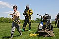 U.S. Air Force Senior Master Sgt. Linda Weir, left, a health service manager with the 105th Medical Group, New York Air National Guard, runs a power cable during a field training session on the setup of a mobile 130516-Z-GJ424-058.jpg