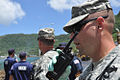 U.S. Army Capt. Michael Rosner, foreground, with the 93rd Civil Support Team, Hawaii Army National Guard, communicates using a handheld radio during a humanitarian aid mission in Pago Pago, American Samoa 091003-F-LX971-178.jpg