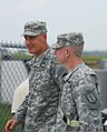 U.S. Army Gen. David M. Rodriguez, left, the commander of Army Forces Command, walks with Col. Bret Van Camp, the commander of the 1st Maneuver Enhancement Brigade, during exercise Vibrant Response 13 at Forward 120731-A-ZZ999-296.jpg