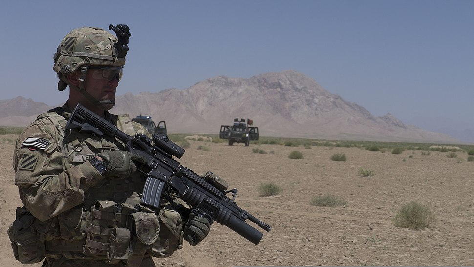 U.S. Army Spc. Mickie Lerma, with the 5th Squadron, 7th Cavalry Regiment, 1st Armored Brigade Combat Team, 3rd Infantry Division, Combined Task Force Raider, provides security for his team during the Afghan 130610-A-QA210-280