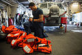 U.S. Navy Boatswain's Mate Seaman Ricky Jones conducts an inventory of deck equipment in preparation for a crew turnover aboard the littoral combat ship USS Freedom (LCS 1) in the Strait of Singapore 130801-N-JN664-183.jpg