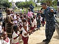 U.S. Navy Musician 2nd Class Kori Gillis, assigned to the U.S. Naval Forces Europe Band ensemble Flagship, sings and dances with children at the Integracao Infantil Cristo Vida school in Nacala, Mozambique 120621-N-GA722-057.jpg