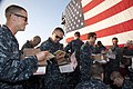 U.S. Sailors aboard the guided missile cruiser USS Gettysburg (CG 64) open care packages during a visit from Operation Gratitude in the Gulf of Oman Dec. 12, 2013 131212-N-PL185-546.jpg