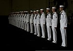 U.S. Sailors with a burial detail stand at attention in the hangar bay aboard the aircraft carrier USS Carl Vinson (CVN 70) June 28, 2013, during a burial at sea in the Pacific Ocean 130628-N-GZ277-031.jpg