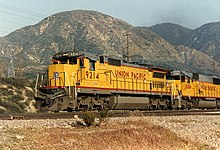union pacific railroad ge dash 8-40c #9214 leads a freight train up cajon  pass