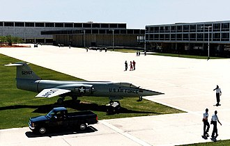 United States Air Force Academy, Cadet Area - A view of the Terrazzo from the chapel wall, showing (left to right) Fairchild Hall, Mitchell Hall and Sijan Hall with an F-104 static display (since replaced by an F-15 Eagle) in the foreground