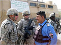 US Army 51761 U.S. Soldiers from 3rd battalion, 82nd Field Artillery Regiment, 2nd Brigade Combat Team, 1st Cavalry Division, meet with Iraqi Emergency Response Unit members and gather information during an ERU che.jpg