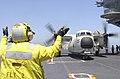 US Navy 020806-N-1974E-001 C-2 Greyhound receives instructions from flight deck director.jpg