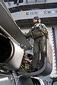US Navy 030412-N-0275F-501 A member of the flight crew nspects an SH-60F Seahawk before flight aboard USS Theodore Roosevelt (CVN 71).jpg