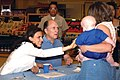 US Navy 030614-N-3983C-001 Actor-Writer-Director Robert Duvall and Actress Luciana Pedraza sign autographs in the Naval Air Station Sigonella Commissary for Sailors and their family members.jpg