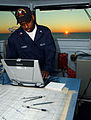 US Navy 031024-N-6653C-001 Quartermaster 2nd Class Danny Wimbish, from Atlanta, Ga., creates deck log entries.jpg