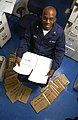 US Navy 040725-N-1485H-029 Personnelman 3rd Class Michael Craig of San Jose, Calf., organizes hundreds of enlisted service records in the personnel office aboard USS Kitty Hawk (CV 63).jpg