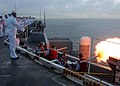 US Navy 040726-N-6433N-008 Weapons Department Sailors render a gun salute while the Nimitz class aircraft carrier USS George Washington (CVN 73) transits up the Chesapeake Bay.jpg