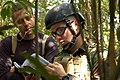 US Navy 050312-N-5781F-009 Aviation Ordnanceman 1st Class Brian Fitzgerald, right, assigned to Explosive Ordnance Disposal Mobile Unit Five (EODMU-5), assesses the type of explosive booby trap he has to disarm during jungle war.jpg