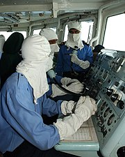Pakistan Navy's sailors wearing anti-flash gear while operating a Guided missile frigate, PNS Alamgir