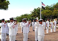 US Navy 050711-N-8937A-032 Japanese Maritime Self Defense Force (JMSDF) Master Chief Kawase leads the JMSDF Band in playing Taps.jpg