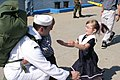 US Navy 050908-N-0653J-004 A Sailor assigned to the Los Angeles-class attack submarine USS Augusta (SSN 710) welcomes family members on the pier after returning home from deployment.jpg