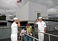 US Navy 051021-N-3019M-004 Sailors assigned to the USS Arizona Memorial Detachment render a salute to Pearl Harbor Survivor Hubert Harry Keil as he departs the USS Arizona Memorial.jpg