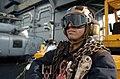 US Navy 051206-N-3488C-059 Airman Sean Casella waits for an F-A-18F Super Hornet o launch off the flight deck.jpg