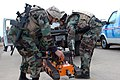 US Navy 060830-N-9195K-019 Two Sailors assigned to Naval Special Clearance Team One (NSCT-1) unload a robotic device used for explosive disposal while participating in Seahawk 2006.jpg