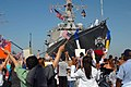 US Navy 070523-N-7653W-117 Family and friends welcome home Sailors assigned to guided-missile destroyer USS Mason (DDG 87) as they return to Naval Station Norfolk after the longest deployment by a carrier strike group since 200.jpg