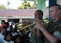 US Navy 070703-N-1752H-083 Sgt. Mark Adams and Cpl. Bobby Sullivan, of the Marine Corps Pacific Band, perform for the local children during medical-dental civic affairs programs held at Tabaco Elementary School.jpg