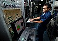US Navy 070713-N-7981E-108 Information Systems Technician Seaman Jaron Franck monitors the ship's automated digital networking system from the radio communication center aboard Nimitz-Class aircraft carrier USS Abraham Lincoln.jpg