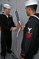US Navy 071215-N-8269F-001 Two Sailors prepare to raise the commissioning pennant at the commissioning ceremony for USS Mesa Verde (LPD 19).jpg