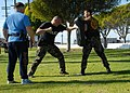 US Navy 080116-N-8607R-045 Department of Defense police and active duty and reserve service members fight each other during an obstacle course that tests how well they can defend themselves with impaired vision.jpg